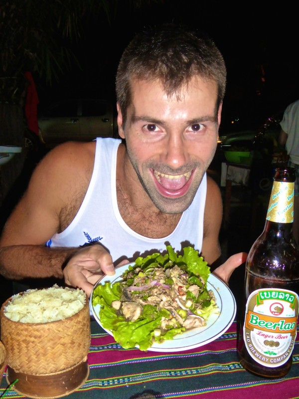Seb enjoying buffalo laap with sticky rice and a Beerlao