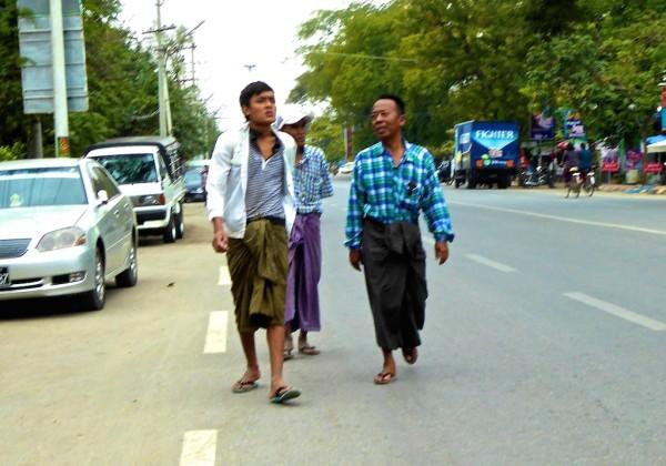 Burmese men wearing longyis