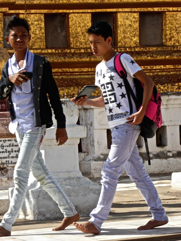 Burmese boys wearing very fashionable tight jeans