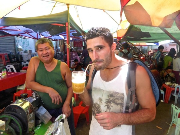 Stefan tucking into sugar cane juice drink