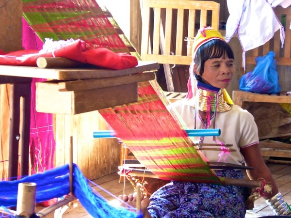 Long necked woman of the Kayan tribe weaving at Inle Lake