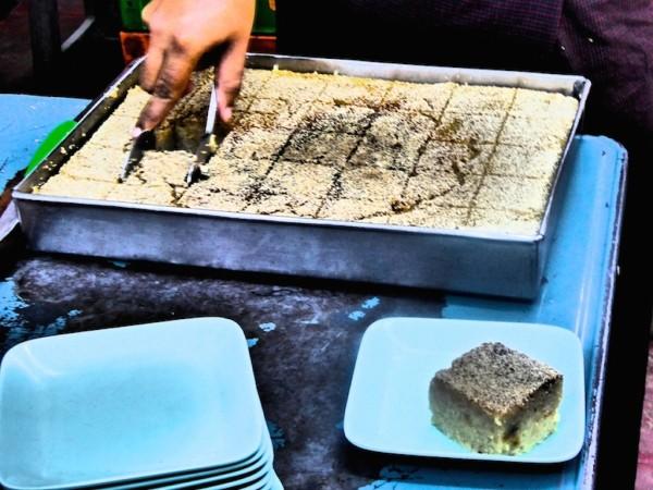 Freshly made semolina cakes in a Yangon tea house