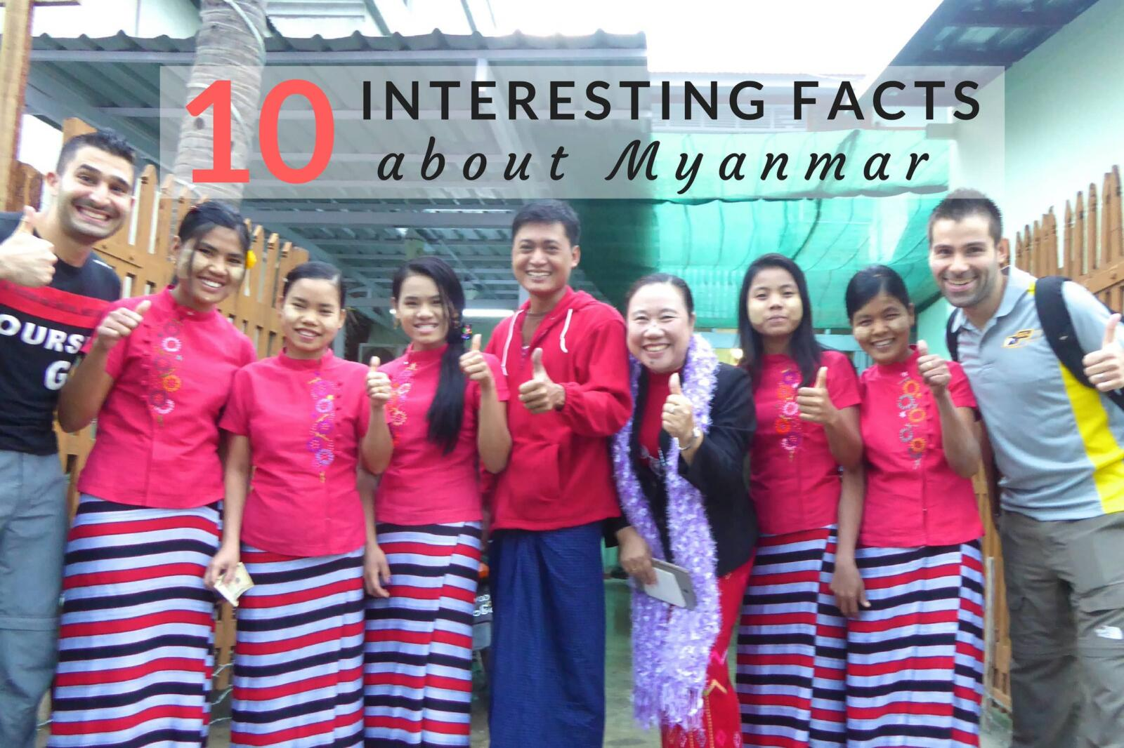 Posing with group of Burmese wearing longyi
