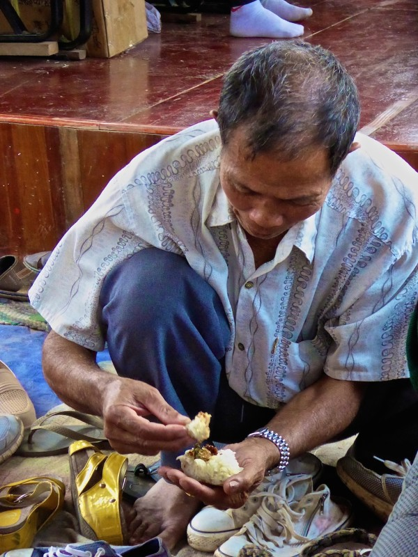 Man eating sticky rice with fingers