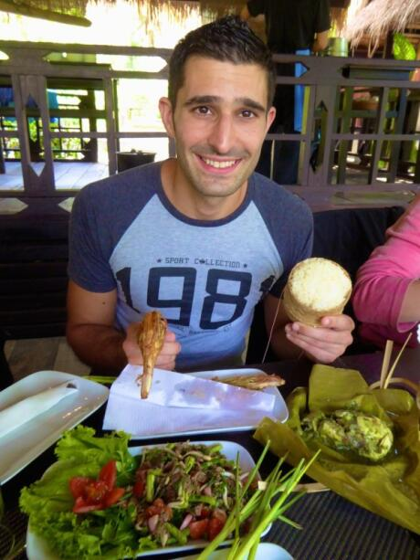 Facts about Laos: Stefan with buffalo laap and sticky rice