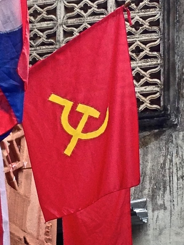 The communist flag flying high in Luang Prabang