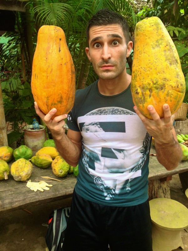 Stefan astonished by the gigantic papayas in Laos