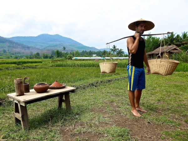 Sebastien carrying the rice grains