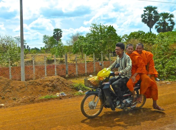 Getting from Phnom Penh to Siem Reap: monks on motorbike