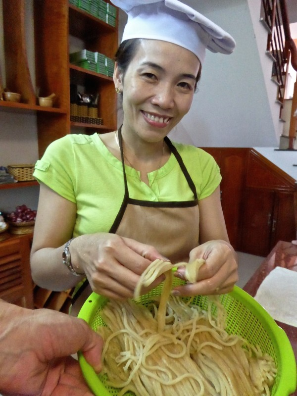 Fresh Cao Lau noodles need to be separated before cooking
