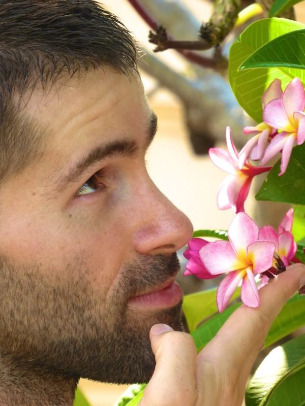 Sebastien admiring a plumeria flower