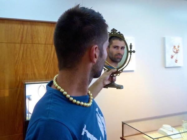Sebastien admiring this golden pearl necklace