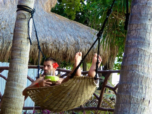Sebastien relaxing in hammock on Flower Island Resort