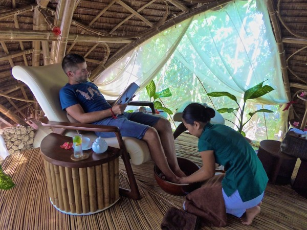 Sebastien enjoying a foot massage at Mandala Spa