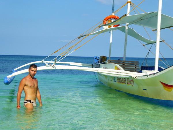 Sebastien with bangka boat at Carubao island