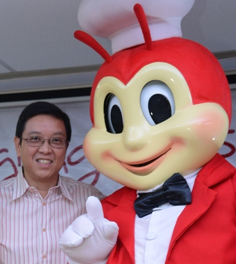 Jollibee mascot with founder Tony Tran
