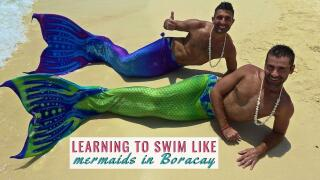 Nomadic Boys learning to swim like a mermaid at Boracay