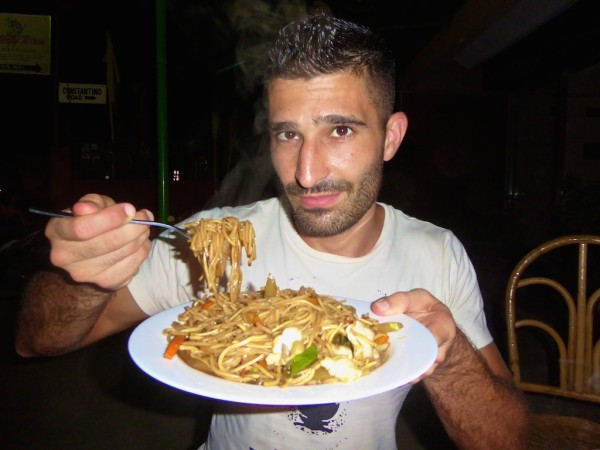 Stefan trying pancit noodles