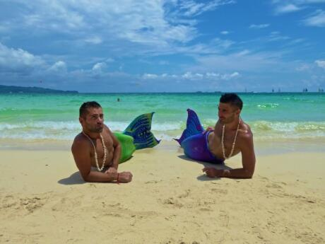 Nomadic Boys posing as gay mermaids on Boracay islands in the Philippines