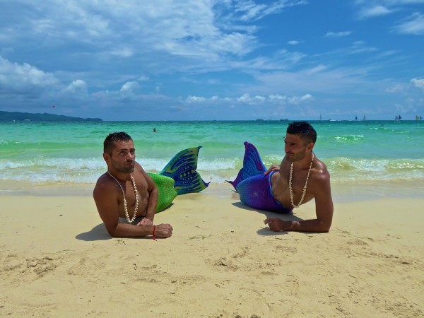 The Nomadic Boys posing as mermaids on Boracay