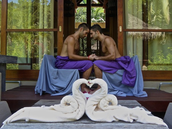 Gay couple travelling in Asia Langkawi island Malaysia
