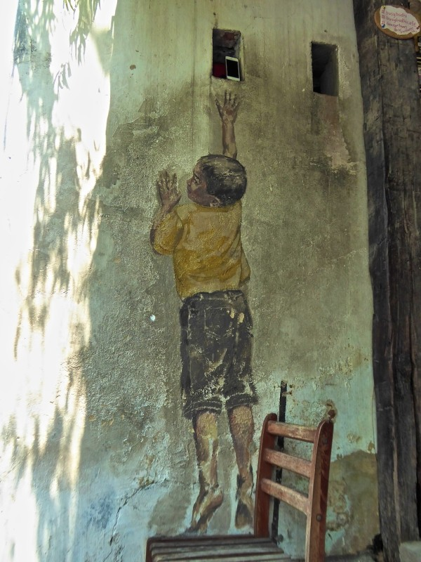Boy on Chair street art in Penang