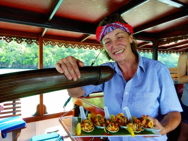 Eva of Damai Indah serving food on board
