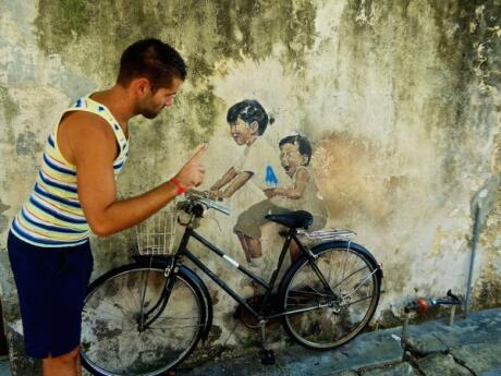 Sebastien had fun pretending to tell of these kids at one of our favourites of Penang's street murals