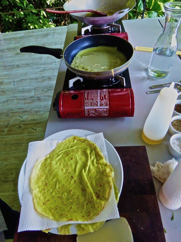 Pandan pancakes stacked on kitchen roll