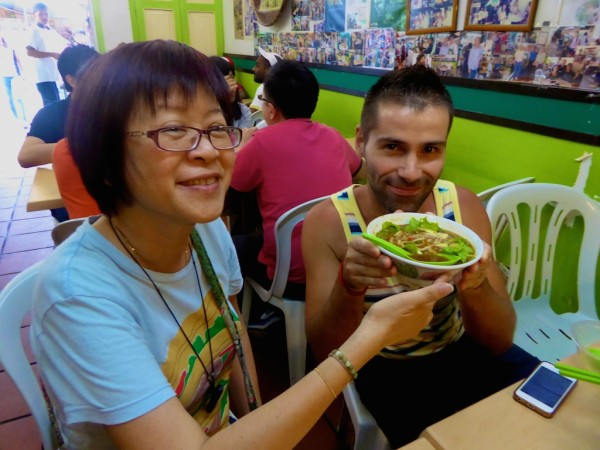 Sebastien trying laksa during our food tour