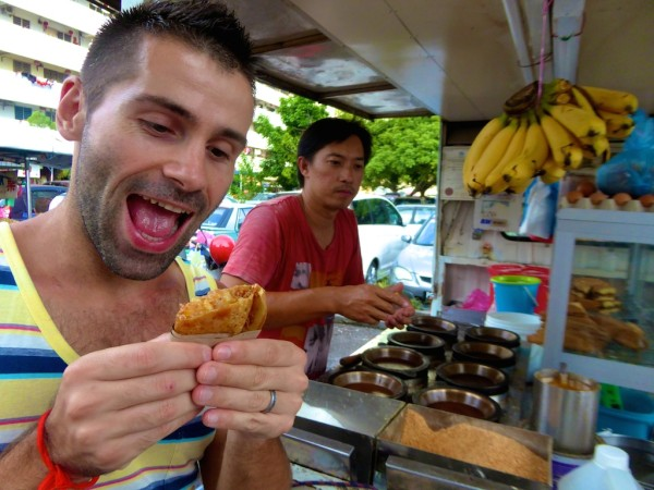 Sebastien trying a Chinese crepe in Penang