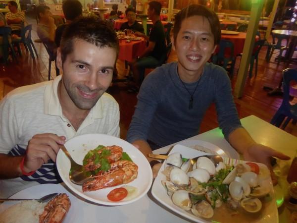 Sebastien and Jason enjoying seafood in Sandakan