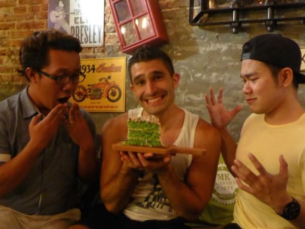 Stefan with pandan gula apong cake in Kuching Sarawak Malaysia