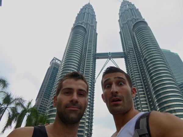 Posing by Petronas Towers at Kuala Lumpur, Malaysia