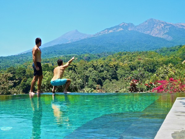 View of Rinjani Volcano peak from Rinjani Lodge infinity pool, Senaru Village in Lombok