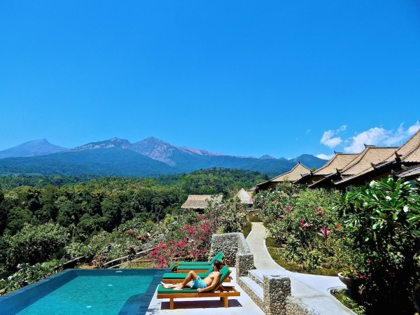 View of Mount Rinjani from infinity pool at Rinjani Lodge at Senaru Village