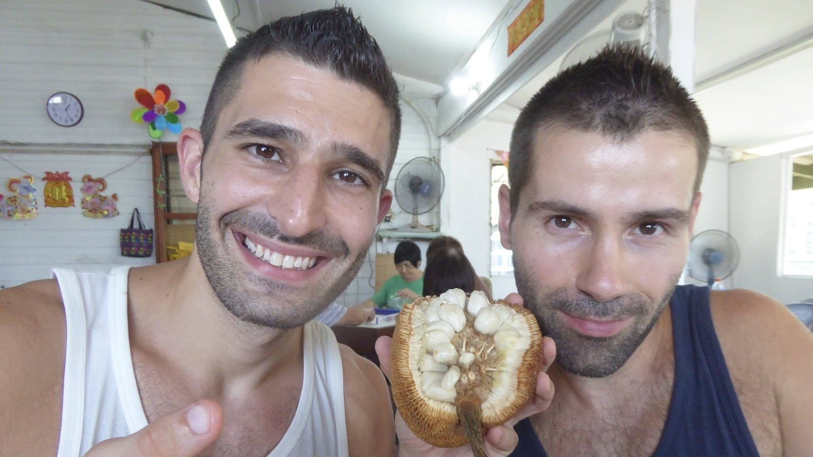 Gay couple trying the tarap fruit in Borneo Malaysia