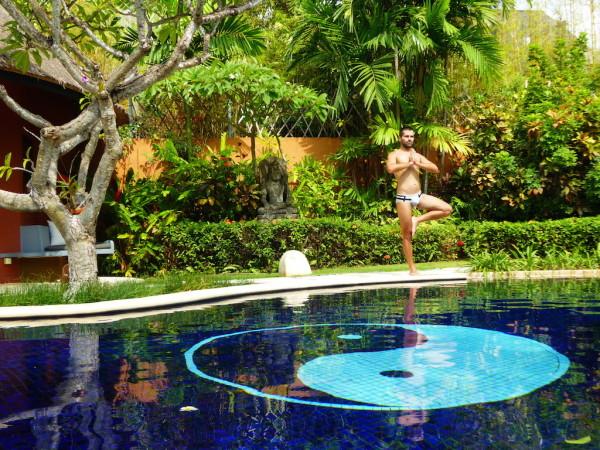 Yoga by the pool at Villas Bali Hotel in Seminyak
