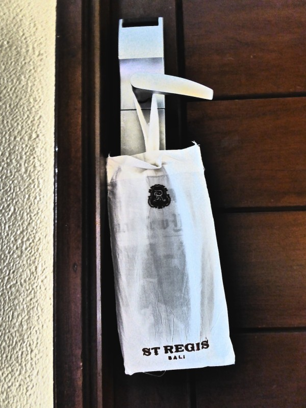 Butler service morning newspaper delivery at the St. Regis