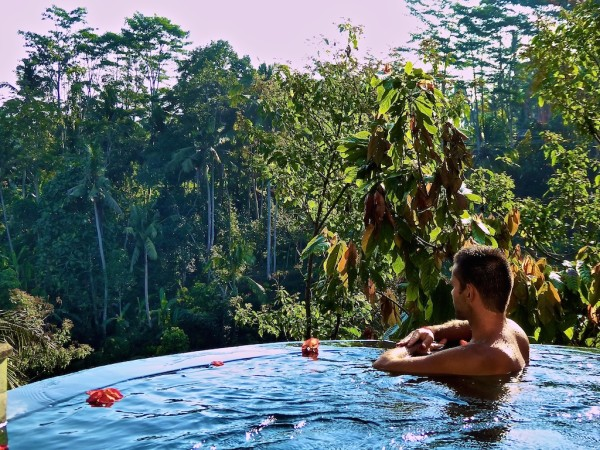 Sebastien enjoying our infinity pool at Villa Awang Awang in Ubud, Indonesia