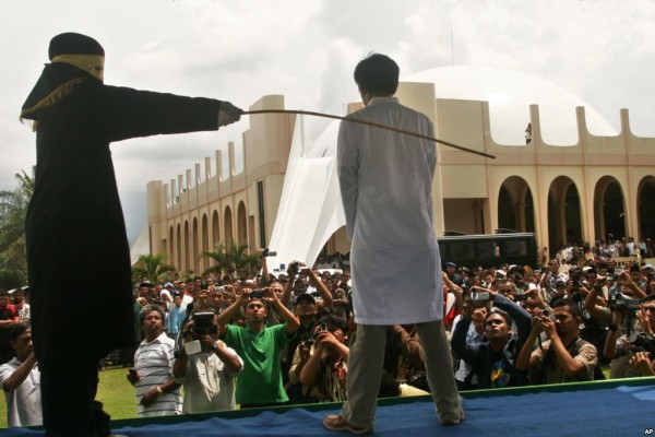 Public caning Sharia anti gay laws in Aceh province Indonesia