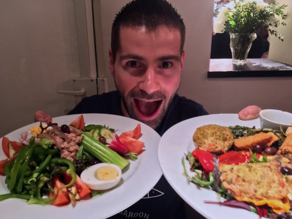 Sebastien discovering Nice food during Queernaval France's first gay carnival