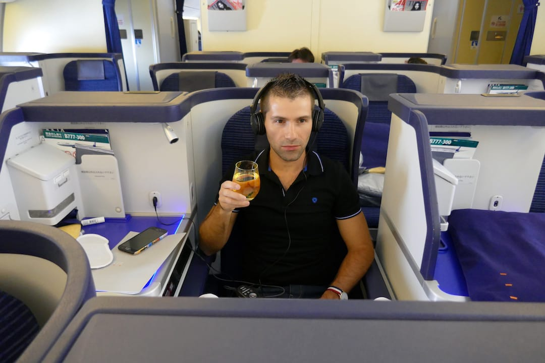 ANA business class review Seb with champagne