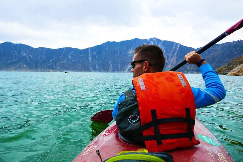 kayaking on quilotoa lake one of 6 awesome things to do in ecuador