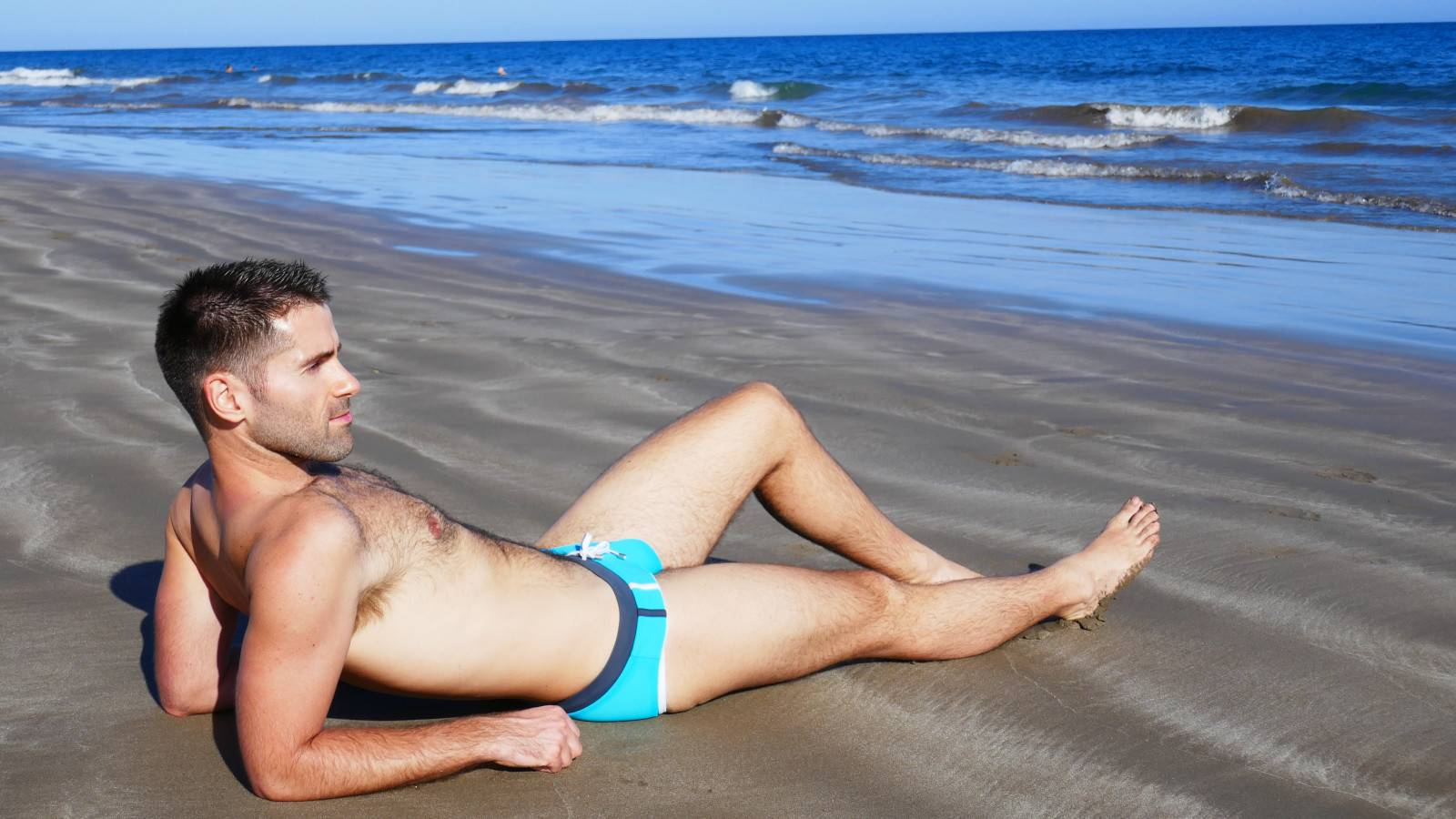 Sebastien from Nomadic Boys chilling on a gay beach in Gran Canaria