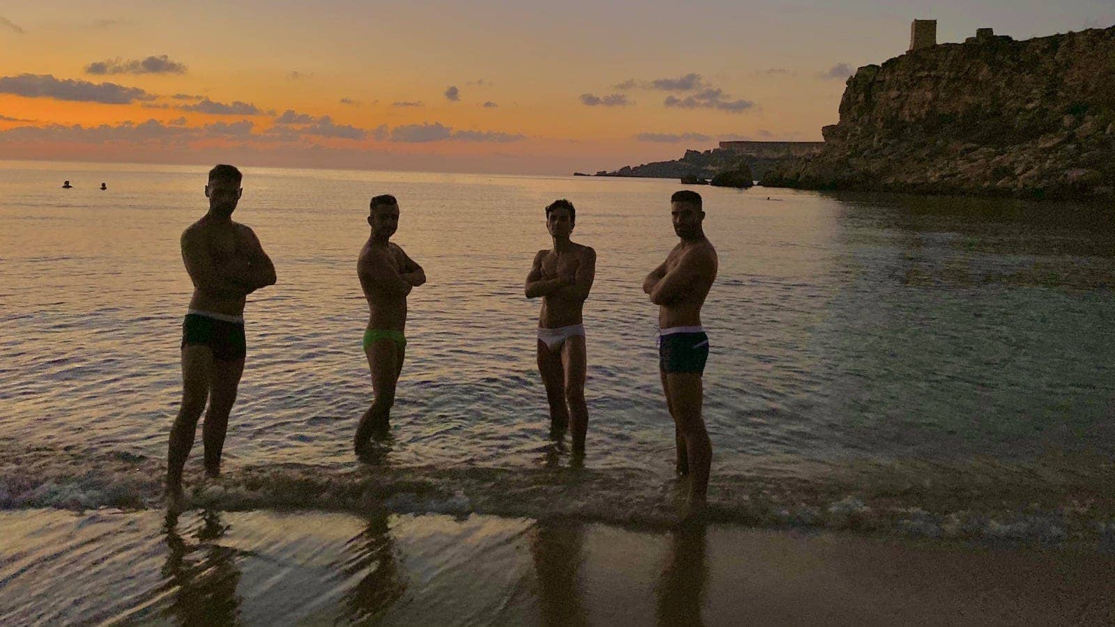 Gay guys posting at the Il Buco gay beach Italy
