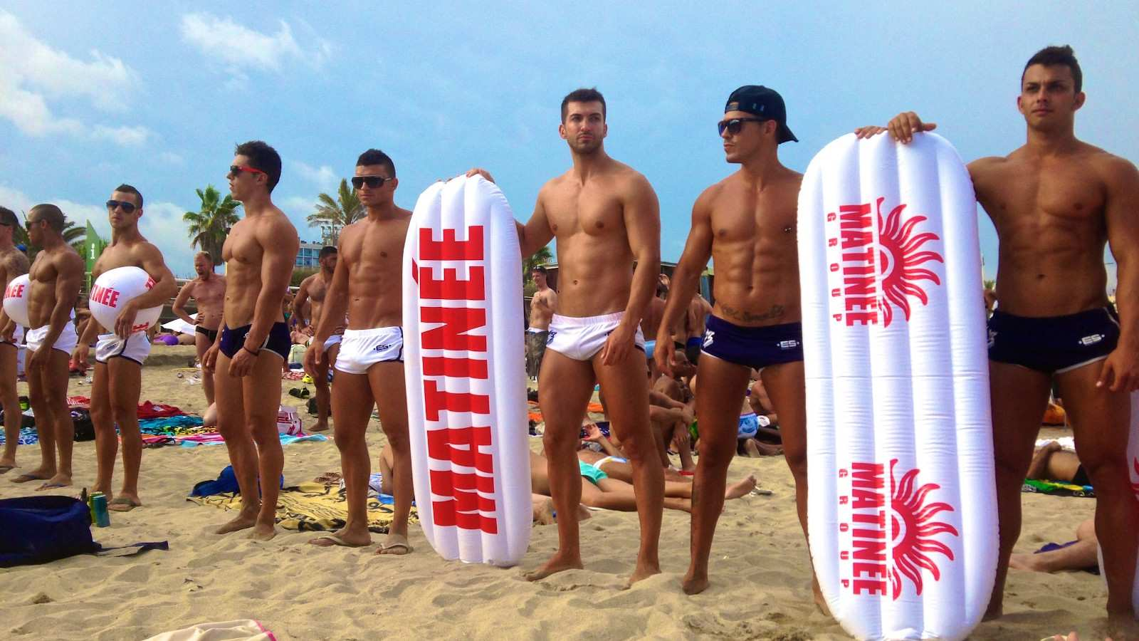 Hot boys, on Mar Bella beach, Barcelona one of the gayest cities in Spain