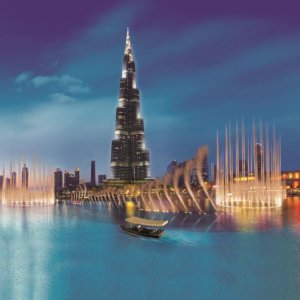 You can experience the Dubai lake fountain show from a boat with stunning views of the Burj Khalifa.