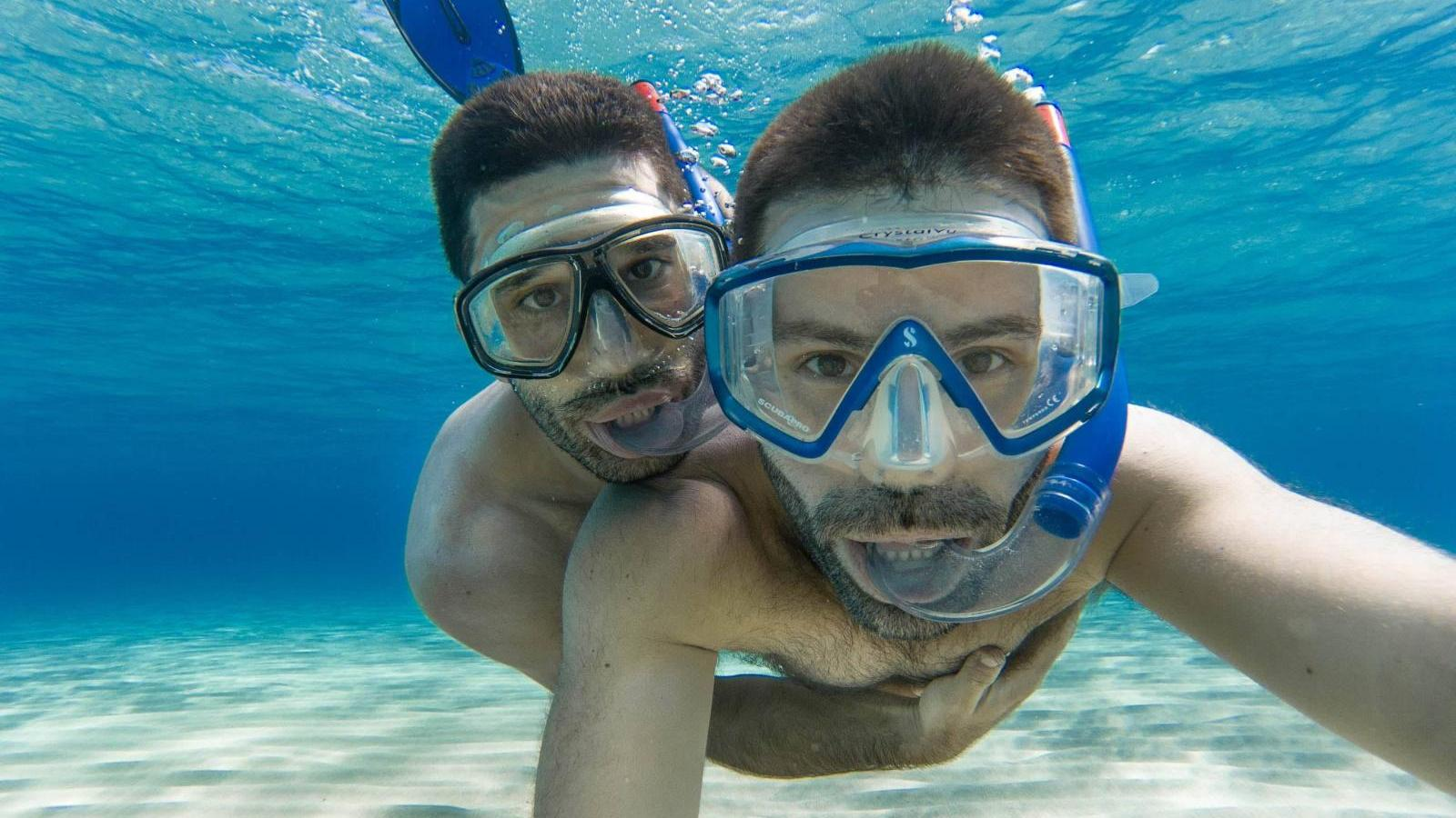 Gay couple snorkeling