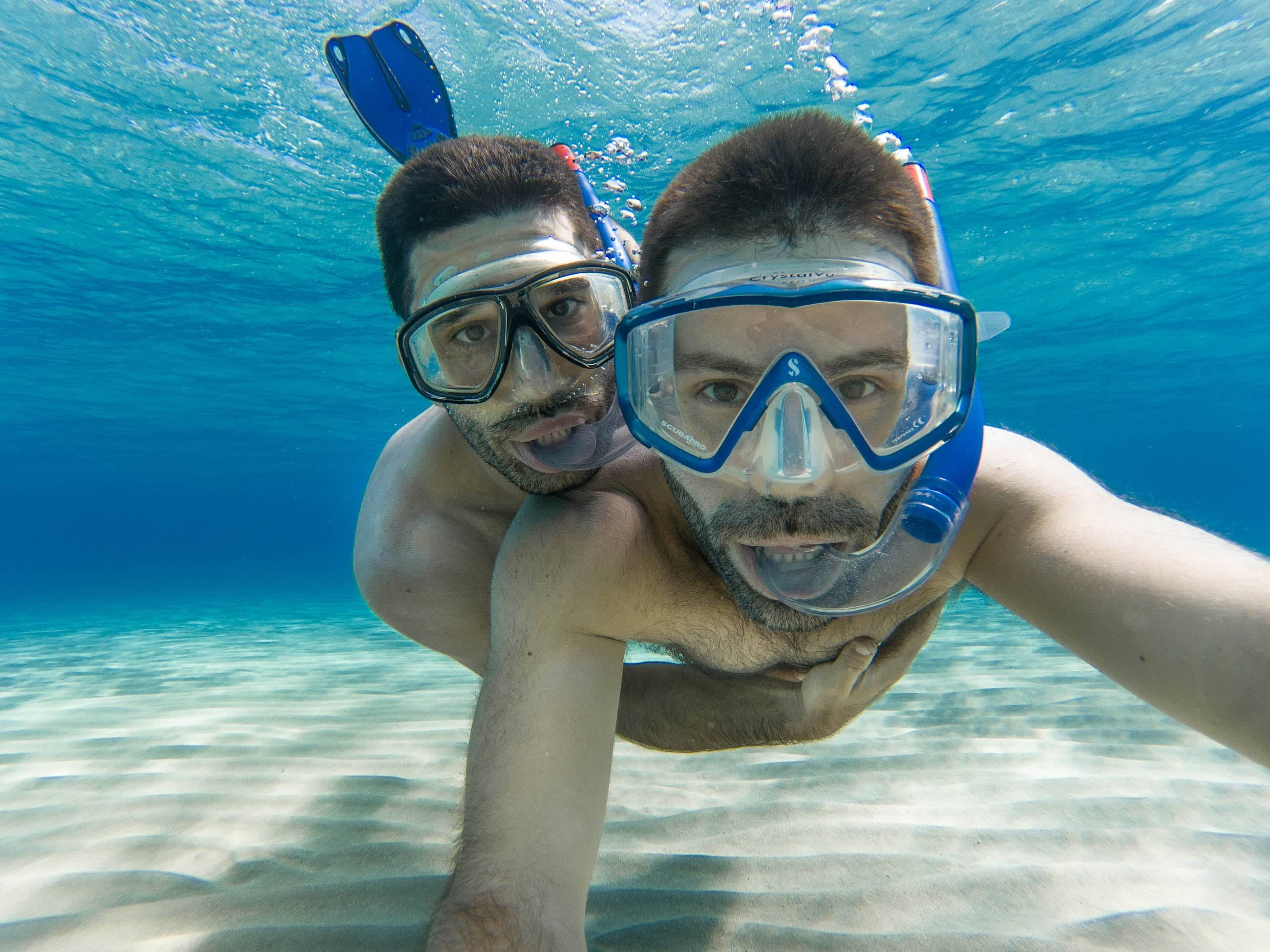 Gay couple snorkelling